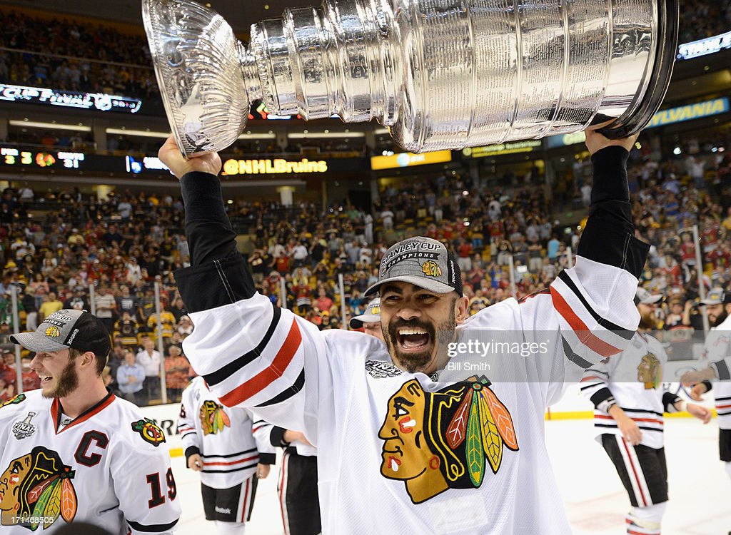Jamal Mayers #22 of the Chicago Blackhawks hoists the Stanley Cup after his team defeated the Boston Bruins 3-2 in Game Six of the 2013 Stanley Cup Final at TD Garden on June 24, 2013 in Boston, Massachusetts. The Chicago Blackhawks won the series 4-2 to win the Stanley Cup.