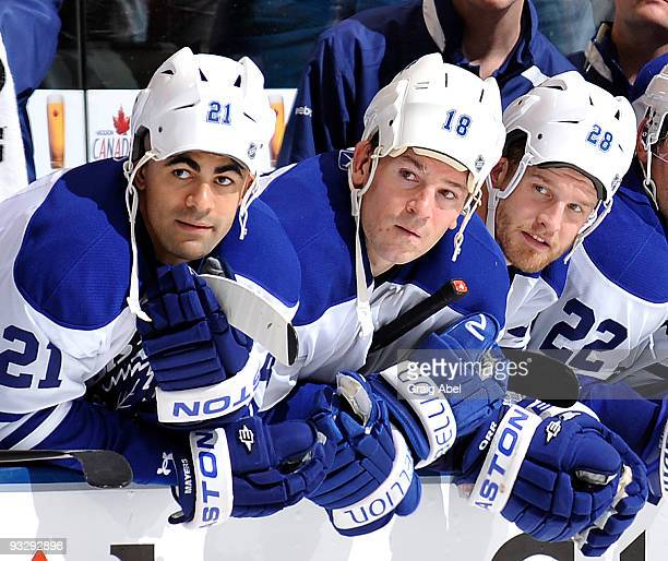 Jamal Mayers Wayne Primeau and Colton Orr of the Toronto Maple Leafs wear their helmets backward during a shoot out against the Washington Capitals...