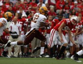 Jamal Miles of the Arizona State Sun Devils returns a kick as Brad Nortman of the Wisconsin Badgers gives chase at Camp Randall Stadium on September...