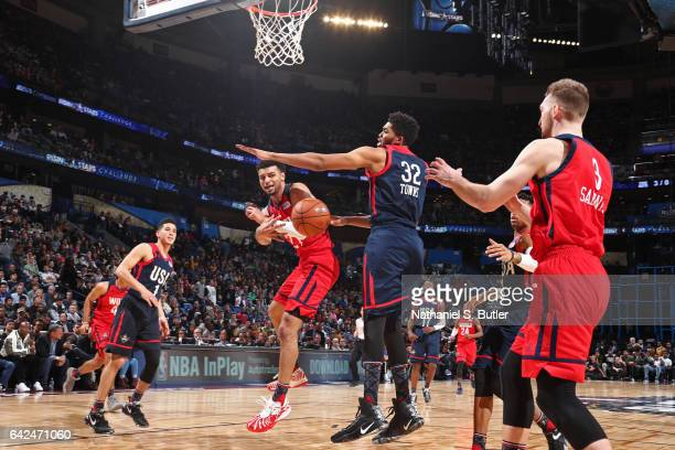 Jamal Murray drives to the basket and passes the ball to Domantas Sabonis of the World Team during the BBVA Compass Rising Stars Challenge as part of...