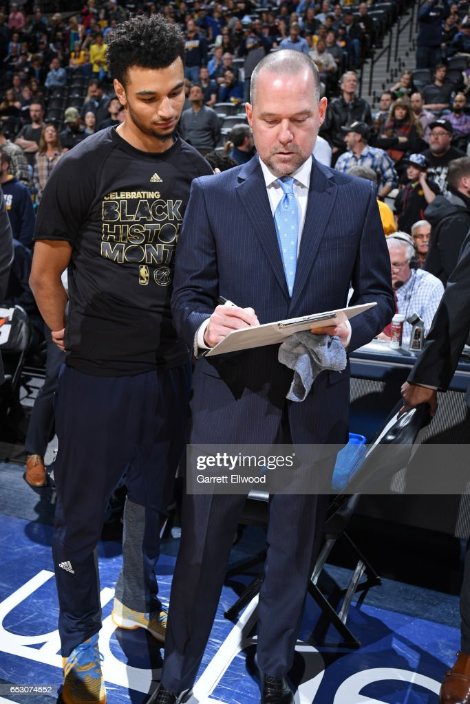Jamal Murray #27 of the Denver Nuggets and Head Coach Michael Malone of the Denver Nuggets go over a play before the game against the Brooklyn Nets on February 24, 2017 at the Pepsi Center in Denver, Colorado.