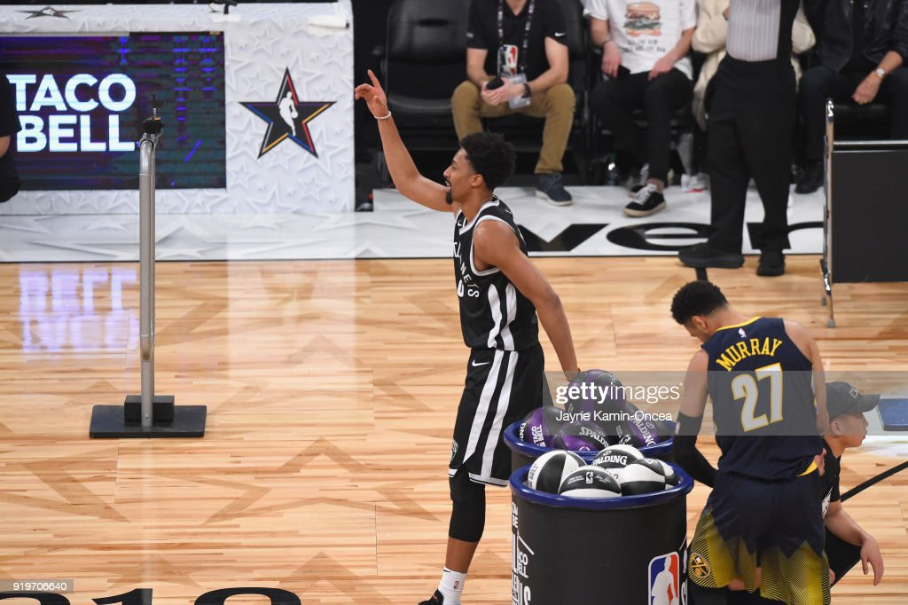 Jamal Murray #27 of the Denver Nuggets and Spencer Dinwiddie #8 of the Brooklyn Nets compete in the 2018 Taco Bell Skills Challenge at Staples Center on February 17, 2018 in Los Angeles, California.