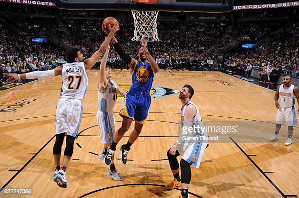 Jamal Murray of the Denver Nuggets blocks the shot against David West of the Golden State Warriors on November 10 2016 at the Pepsi Center in Denver...