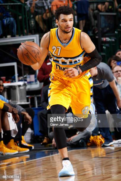 Jamal Murray of the Denver Nuggets brings the ball up court against the Dallas Mavericks during the game on April 11 2017 at the American Airlines...