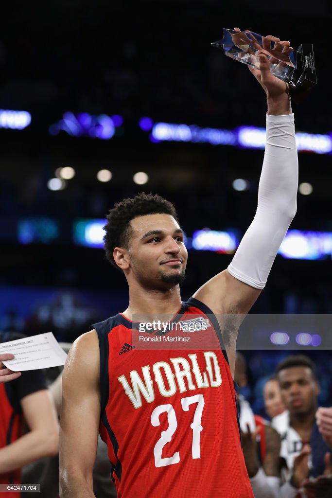 Jamal Murray #27 of the Denver Nuggets celebrates with the 2017 BBVA Compass Rising Stars Challenge MVP trophy after the World Team defeated the US Team 150-141 in the 2017 BBVA Compass Rising Stars Challenge at Smoothie King Center on February 17, 2017 in New Orleans, Louisiana.