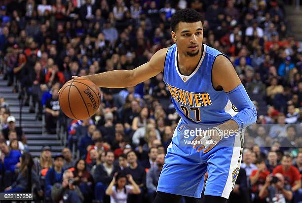 Jamal Murray of the Denver Nuggets dribbles the ball during the first half of an NBA game against the Toronto Raptors at Air Canada Centre on October...