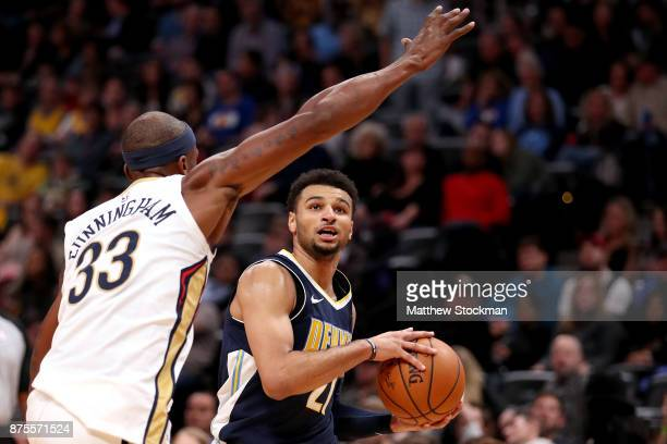 Jamal Murray of the Denver Nuggets drives to the basket against Dante Cunningham of the New Orleans Pelicans at the Pepsi Center on November 17 2017...