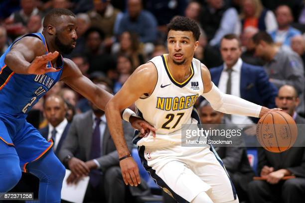 Jamal Murray of the Denver Nuggets drives to the basket against Raymond Felton of the Oklahoma City Thunder at the Pepsi Center on November 9 2017 in...