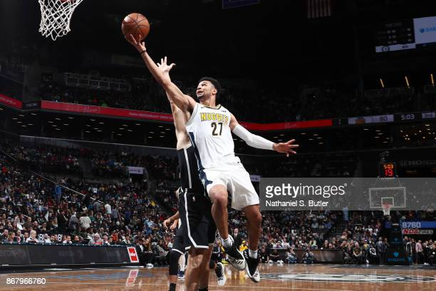 Jamal Murray of the Denver Nuggets drives to the basket against the Brooklyn Nets on October 29 2017 at Barclays Center in Brooklyn New York NOTE TO...