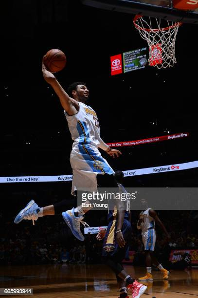 Jamal Murray of the Denver Nuggets goes up for a dunk against the New Orleans Pelicans on April 7 2017 at the Pepsi Center in Denver Colorado NOTE TO...