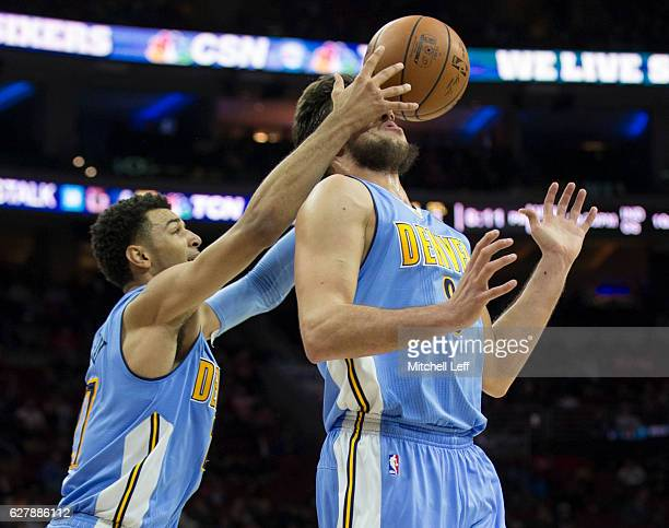 Jamal Murray of the Denver Nuggets grabs a rebound off the face of Danilo Gallinari in the second quarter against the Philadelphia 76ers at Wells...