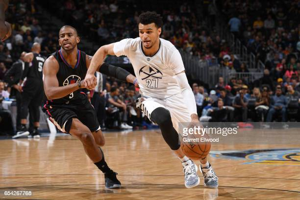Jamal Murray of the Denver Nuggets handles the ball against Chris Paul of the LA Clippers during the game on March 16 2017 at the Pepsi Center in...