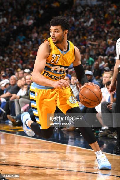 Jamal Murray of the Denver Nuggets handles the ball against the Oklahoma City Thunder on April 9 2017 at the Pepsi Center in Denver Colorado NOTE TO...