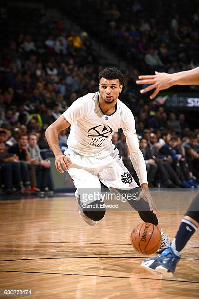Jamal Murray of the Denver Nuggets handles the ball against the Dallas Mavericks on December 19 2016 at the Pepsi Center in Denver Colorado NOTE TO...
