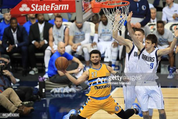 Jamal Murray of the Denver Nuggets passes the ball in front of Nicolas Brussino of the Dallas Mavericks at American Airlines Center on April 11 2017...