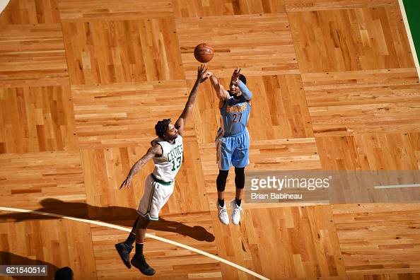 Jamal Murray of the Denver Nuggets shoots the ball against James Young of the Boston Celtics on November 6 2016 at the TD Garden in Boston...