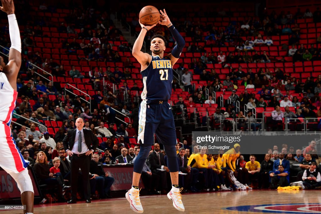 Jamal Murray #27 of the Denver Nuggets shoots the ball against the Detroit Pistons on December 12, 2017 at Little Caesars Arena in Detroit, Michigan.
