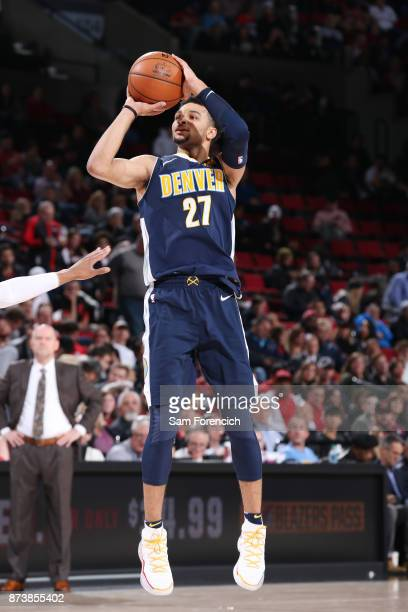 Jamal Murray of the Denver Nuggets shoots the ball against the Portland Trail Blazers on November 13 2017 at the Moda Center in Portland Oregon NOTE...
