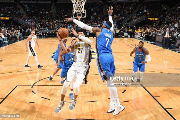 Jamal Murray of the Denver Nuggets shoots the ball during the preseason game against the Oklahoma City Thunder on October 10 2017 at the Pepsi Center...