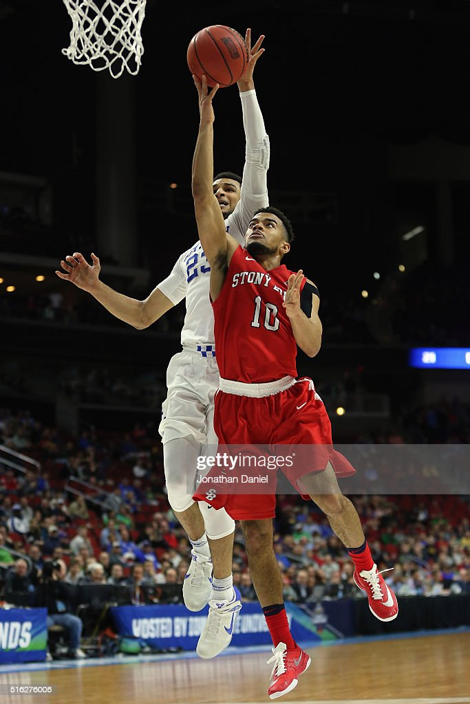 Jamal Murray #23 of the Kentucky Wildcats blocks a shot by Carson Puriefoy #10 of the Stony Brook Seawolves in the second half during the first round of the 2016 NCAA Men's Basketball Tournament at Wells Fargo Arena on March 17, 2016 in Des Moines, Iowa.