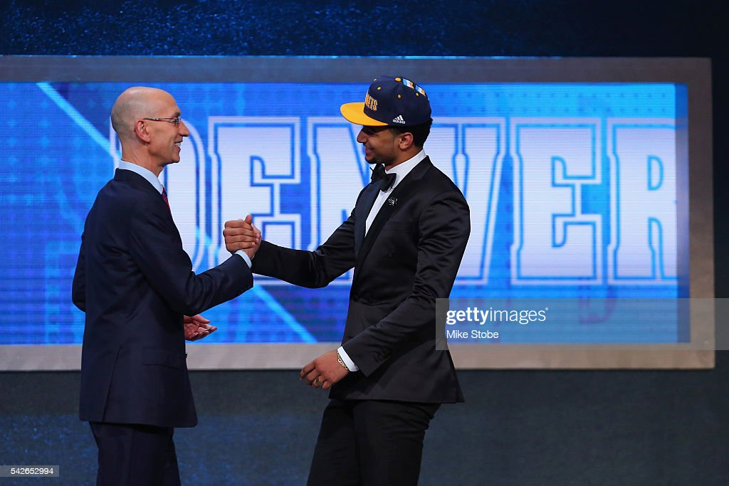 Jamal Murray shakes hands with Commissioner Adam Silver after being drafted seventh overall by the Denver Nuggets in the first round of the 2016 NBA Draft at the Barclays Center on June 23, 2016 in the Brooklyn borough of New York City.