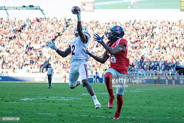 Jamal Peters of the Mississippi State Bulldogs intercepts a pass in the touchdown thrown to Quincy Adeboyejo of the Mississippi Rebels at...