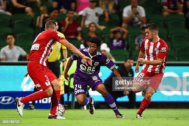 Jamal Reiners of the Perth Glory looks to break past Aaron Hughes and Ben Garuccio of the Melbourne City FC during the round 15 ALeague match between...