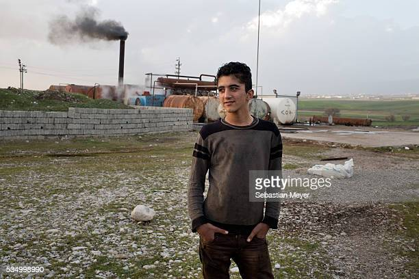 Jamal stands in front of the refinery The family of Yezidis displaced from Sinjar live next to an oil refinery in the Kurdish Region of Iraq The...