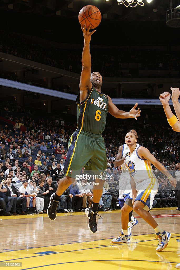 Jamal Tinsley #6 of the Utah Jazz drives to the basket for a layup against the Golden State Warriors on February 2, 2012 at Oracle Arena in Oakland, California.