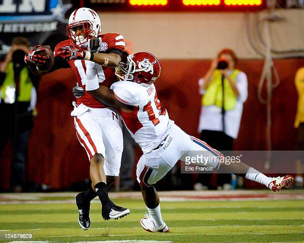 Jamal Turner of the Nebraska Cornhuskers pulls in a pass over Terrance Dennis of the Fresno State Bulldogs during their game at Memorial Stadium...