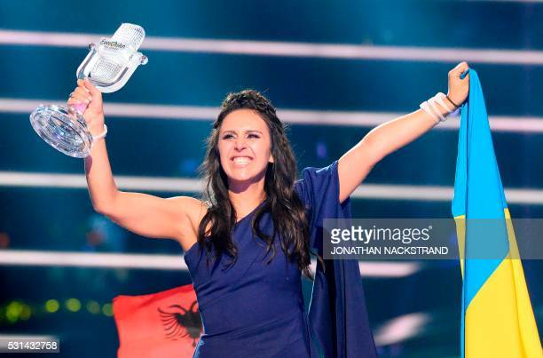 TOPSHOT Jamala representing Ukraine with the song '1944' celebrates with the trophy after winning the final of the Eurovision Song Contest 2016 Grand...