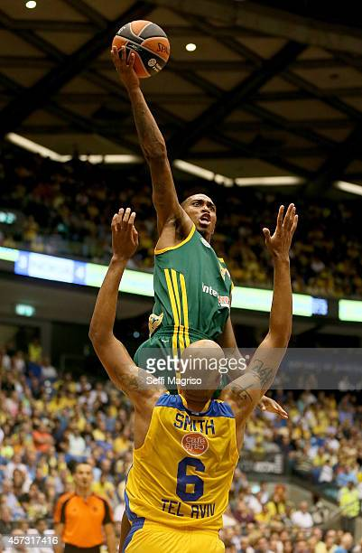 Jamar Smith #5 of Limoges CSP competes with Devin Smith #6 of Maccabi Electra Tel Avi in action during the 20142015 Turkish Airlines Euroleague...