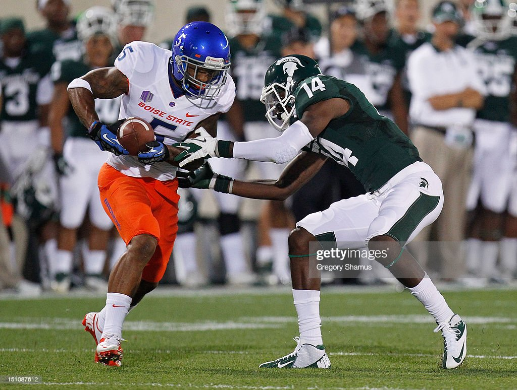 Jamar Taylor #5 of the Boise State Broncos intercepts a first-quarter pass against Tony Lippett #14 of the Michigan State Spartans at Spartan Stadium on August, 2010 in East Lansing, Michigan.
