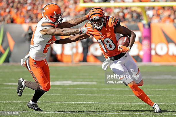 Jamar Taylor of the Cleveland Browns attempts to tackle AJ Green of the Cincinnati Bengals during the first quarter at Paul Brown Stadium on October...