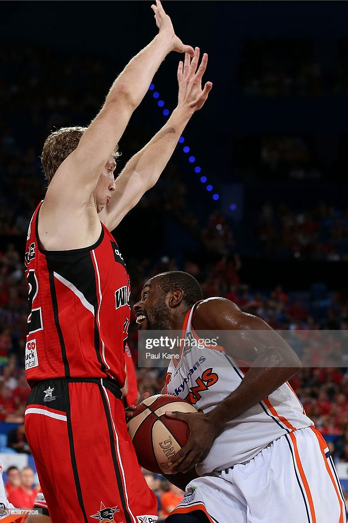Jamar Wilson of the Taipans looks to shoot against Shawn Redhage of the Wildcats during the round 23 NBL match between the Perth Wildcats and the Cairns Taipans at Perth Arena on March 17, 2013 in Perth, Australia.
