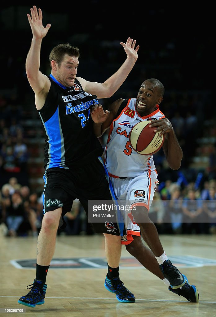 Jamar Wilson of the Taipans pushes past Dillon Boucher of the Breakers during the round 11 NBL match between the New Zealand Breakers and the Cairns...