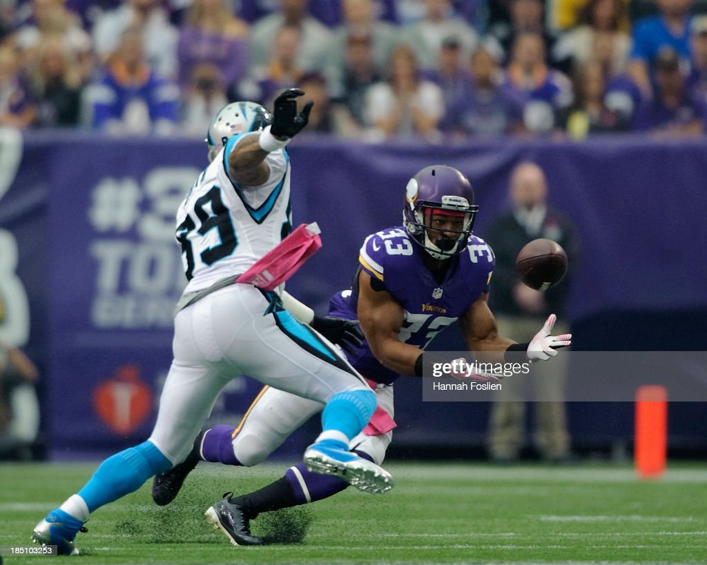 <a gi-track='captionPersonalityLinkClicked' href=/galleries/search?phrase=Jamarca+Sanford&family=editorial&specificpeople=4037205 ng-click='$event.stopPropagation()'>Jamarca Sanford</a> #33 of the Minnesota Vikings attempts to intercept a pass intended from Steve Smith #89 of the Carolina Panthers during the game on October 13, 2013 at Mall of America Field at the Hubert H. Humphrey Metrodome in Minneapolis, Minnesota. The Panthers defeated the Vikings 35-10.