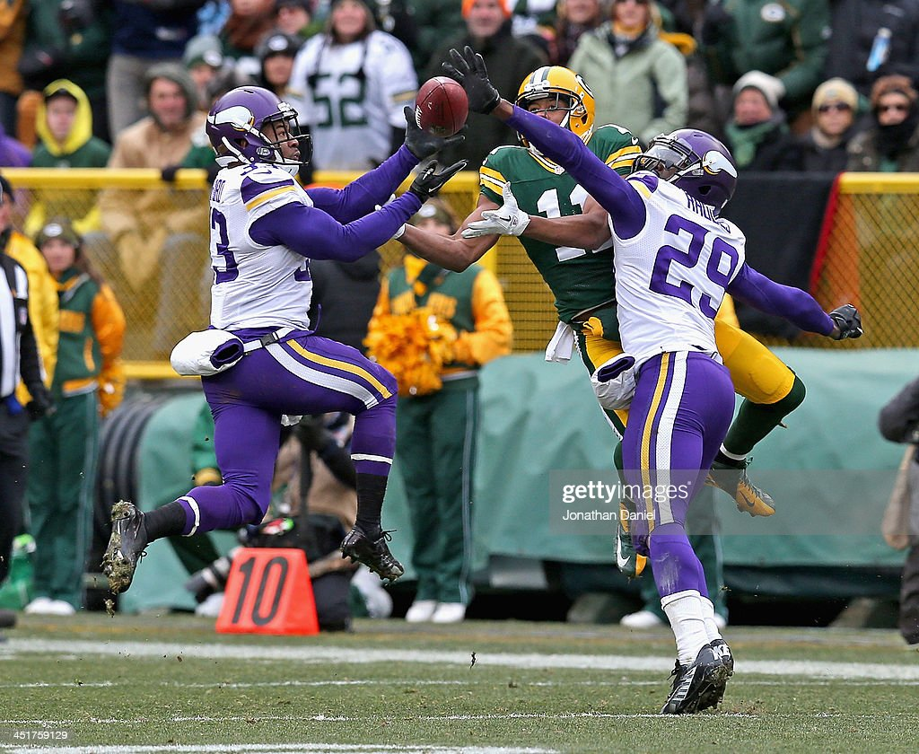 <a gi-track='captionPersonalityLinkClicked' href=/galleries/search?phrase=Jamarca+Sanford&family=editorial&specificpeople=4037205 ng-click='$event.stopPropagation()'>Jamarca Sanford</a> #33 of the Minnesota Vikings breaks up a pass intended for <a gi-track='captionPersonalityLinkClicked' href=/galleries/search?phrase=Jarrett+Boykin&family=editorial&specificpeople=5543648 ng-click='$event.stopPropagation()'>Jarrett Boykin</a> #11 of the Green Bay Packers as <a gi-track='captionPersonalityLinkClicked' href=/galleries/search?phrase=Xavier+Rhodes&family=editorial&specificpeople=7191729 ng-click='$event.stopPropagation()'>Xavier Rhodes</a> #29 also defends at Lambeau Field on November 24, 2013 in Green Bay, Wisconsin.