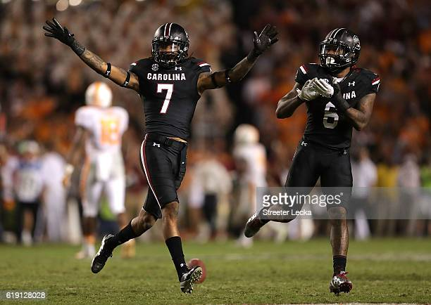 Jamarcus King of the South Carolina Gamecocks celebrates after making an interception with teammate Chris Moody of the South Carolina Gamecocks...