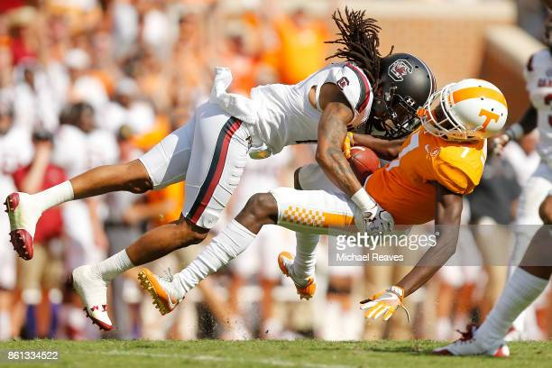JaMarcus King of the South Carolina Gamecocks tackles Brandon Johnson of the Tennessee Volunteers during the second half at Neyland Stadium on...