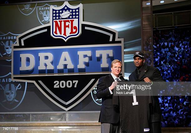 JaMarcus Russell poses with NFL Commissioner Roger Goodell after being chosen first overall by the Oakland Raiders at the 2007 NFL Draft at Radio...