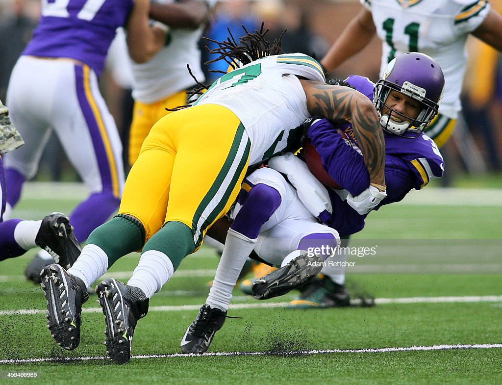 Jamari Lattimore of the Green Bay Packers tackles Marcus Sherels of the Minnesota Vikings in the second half on November 23 2014 at TCF Bank Stadium...
