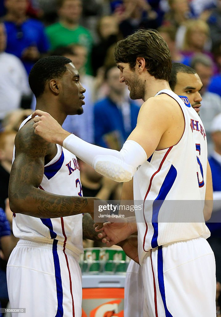 Jamari Traylor #31 and Jeff Withey #5 of the Kansas Jayhawks celebrate their 70-54 win over Kansas State Wildcats during the Final of the Big 12 basketball tournament at Sprint Center on March 16, 2013 in Kansas City, Missouri.