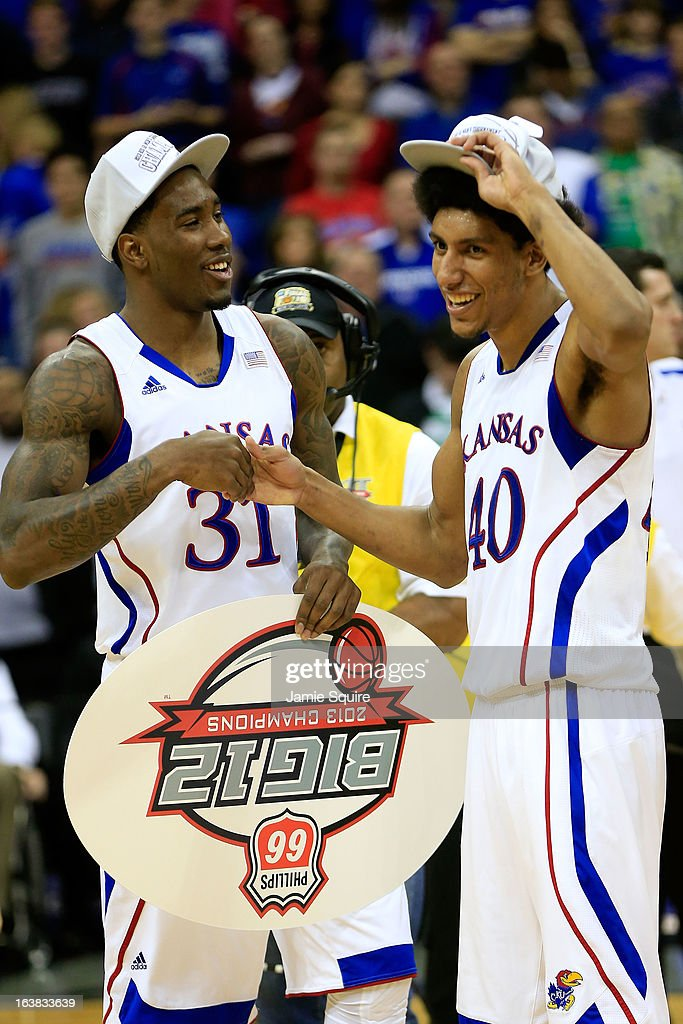 Jamari Traylor #31 and Kevin Young #40 of the Kansas Jayhawks celebrate their 70-54 win over Kansas State Wildcats during the Final of the Big 12 basketball tournament at Sprint Center on March 16, 2013 in Kansas City, Missouri.