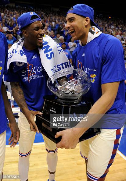 Jamari Traylor and Landen Lucas of the Kansas Jayhawks hold the Big 12 Conference Championship trophy after they defeated Texas Tech Red Raiders 6758...