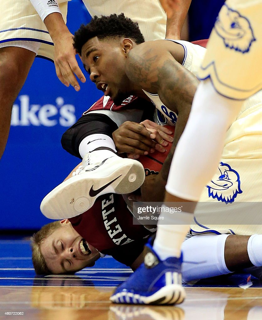 Jamari Traylor of the Kansas Jayhawks battles Dan Trist of the Lafayette Leopards for a loose ball during the game at Allen Fieldhouse on December 20...