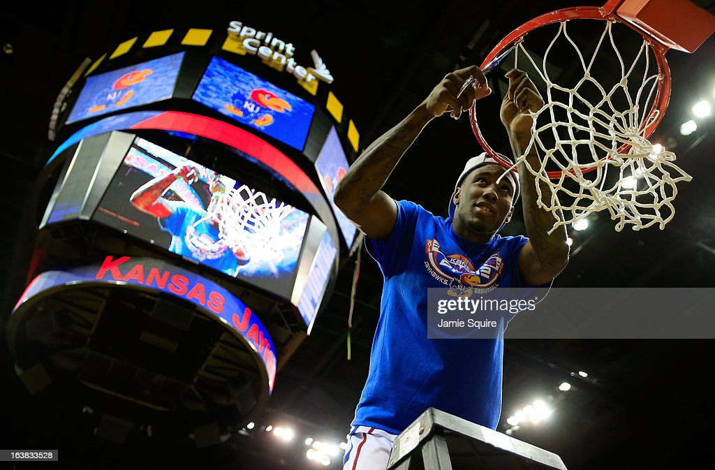 Jamari Traylor #31 of the Kansas Jayhawks cuts the net in celebration of their 70-54 victory over the Kansas State Wildcats during the Final of the Big 12 basketball tournament at Sprint Center on March 16, 2013 in Kansas City, Missouri.
