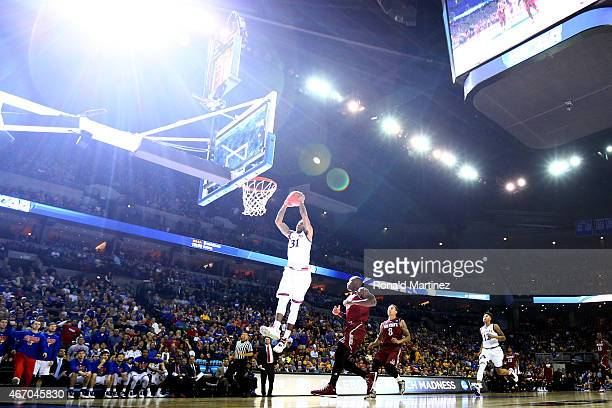 Jamari Traylor of the Kansas Jayhawks dunks against the New Mexico State Aggies during the second round of the 2015 NCAA Men's Basketball Tournament...