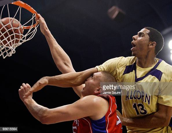 JaMarkus Holt of the Alcorn State Braves tries to block a shot by Cole Aldrich of the Kansas Jayhawks during the game on December 2 2009 at Allen...