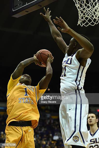 Jamaya Burr of the McNeese State Cowboys is defended by Aaron Epps of the LSU Tigers during the second half of a game at the Pete Maravich Assembly...